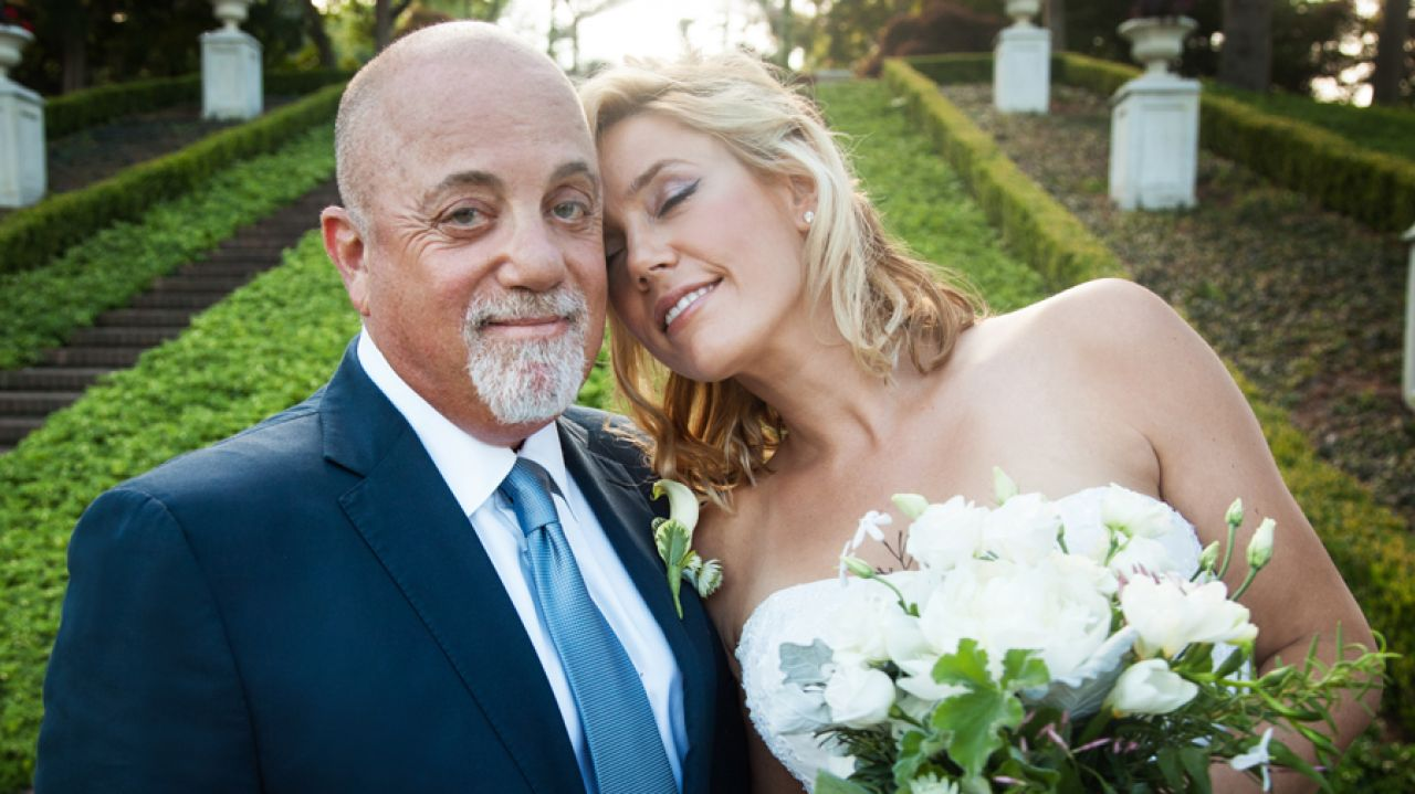 Billy Joel with wife at wedding