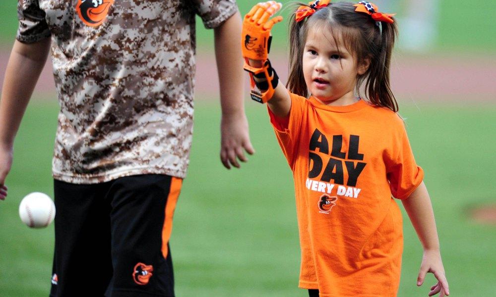 Hailey Dawson throwing a baseball
