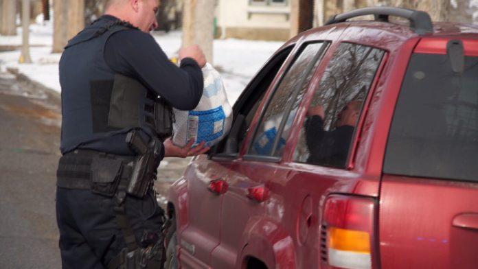 An officer handing out a turkey