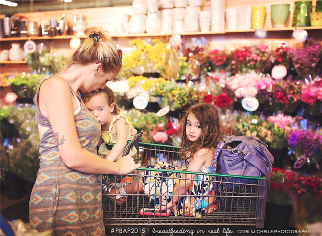 Mother breastfeeding in a grocery store