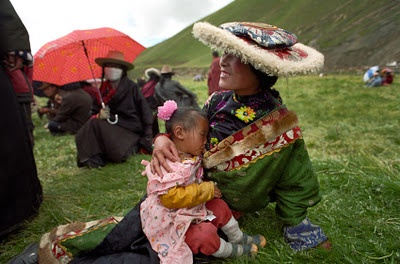 A Tibetan mother breastfeeding her daughter