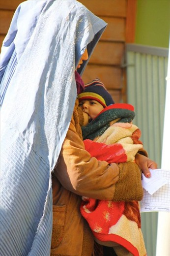 Woman breastfeeding her baby in Afganistan