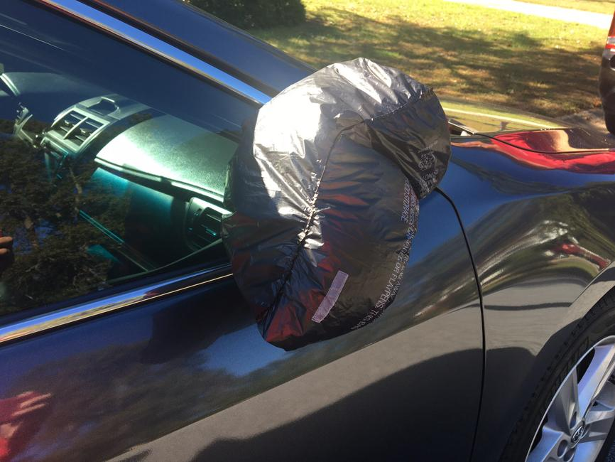 Plastic bag covered car mirror