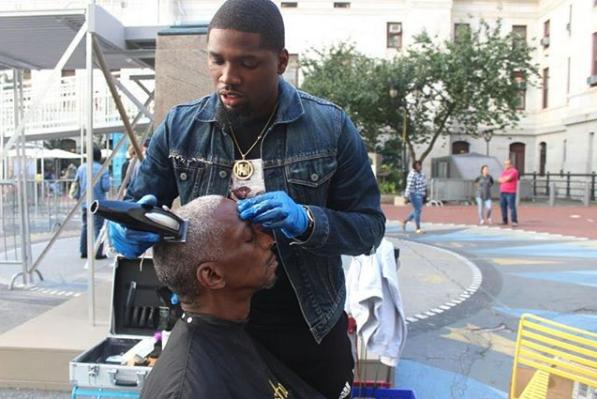 Brennon Jones giving a haircut
