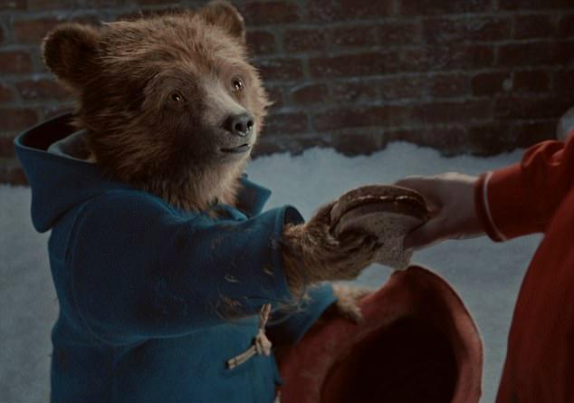 Paddington Bear giving away his sandwich