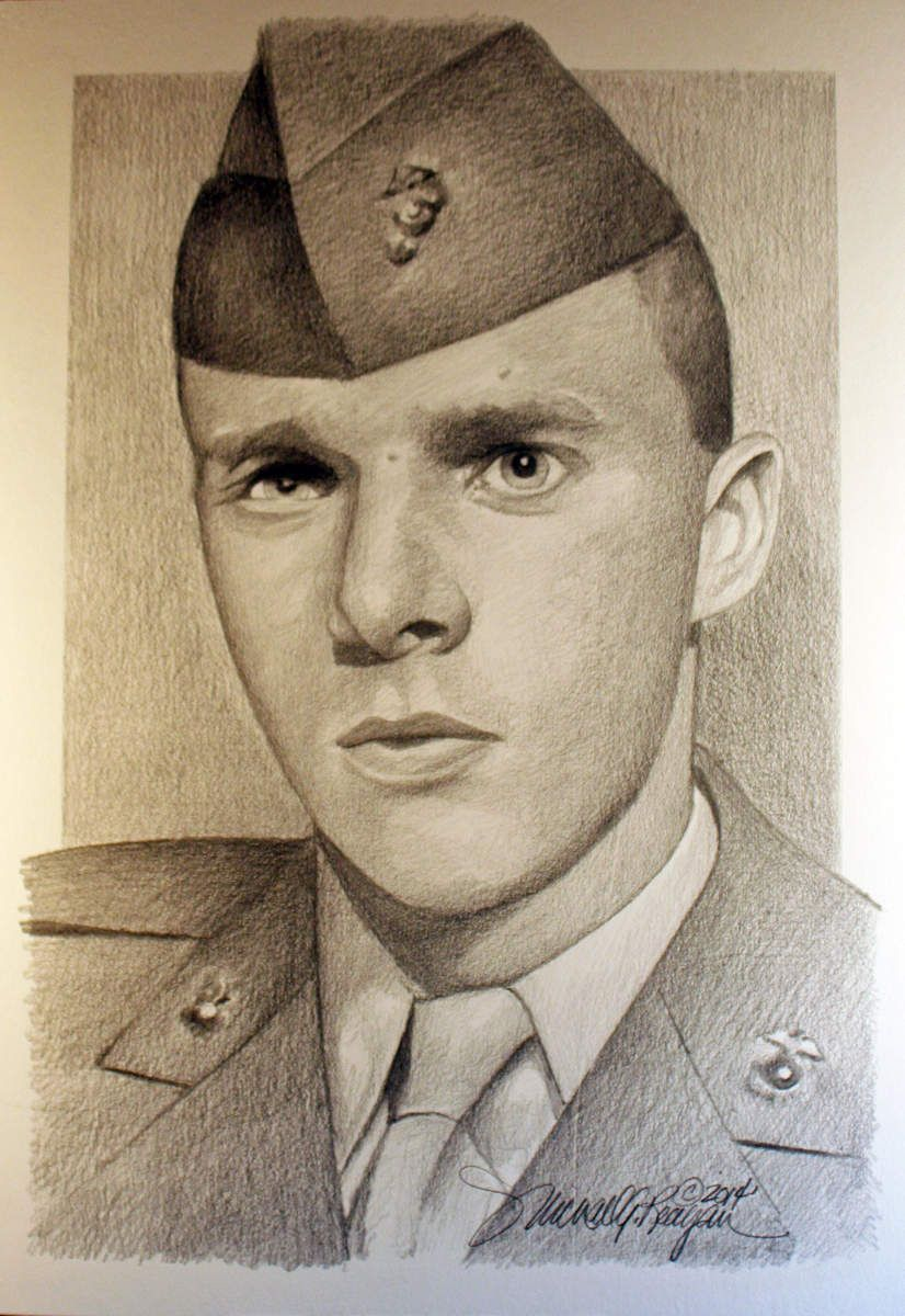 The portrait of a fallen soldier Michael Reagan held in his arms at 19-years-old