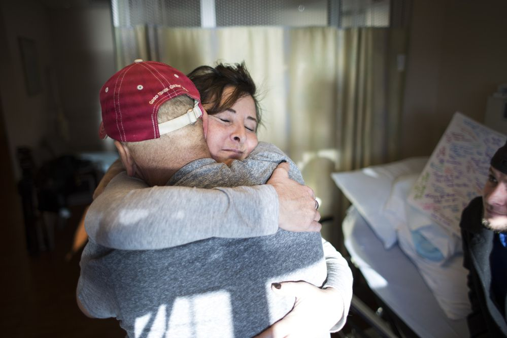 Jamie hugging his wife, Tammy