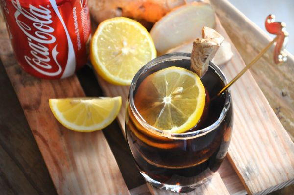 Cure a sore throat with coke.
