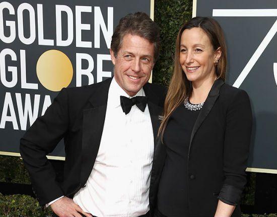Hugh Grant and his girlfriend Anna Eberstein.
