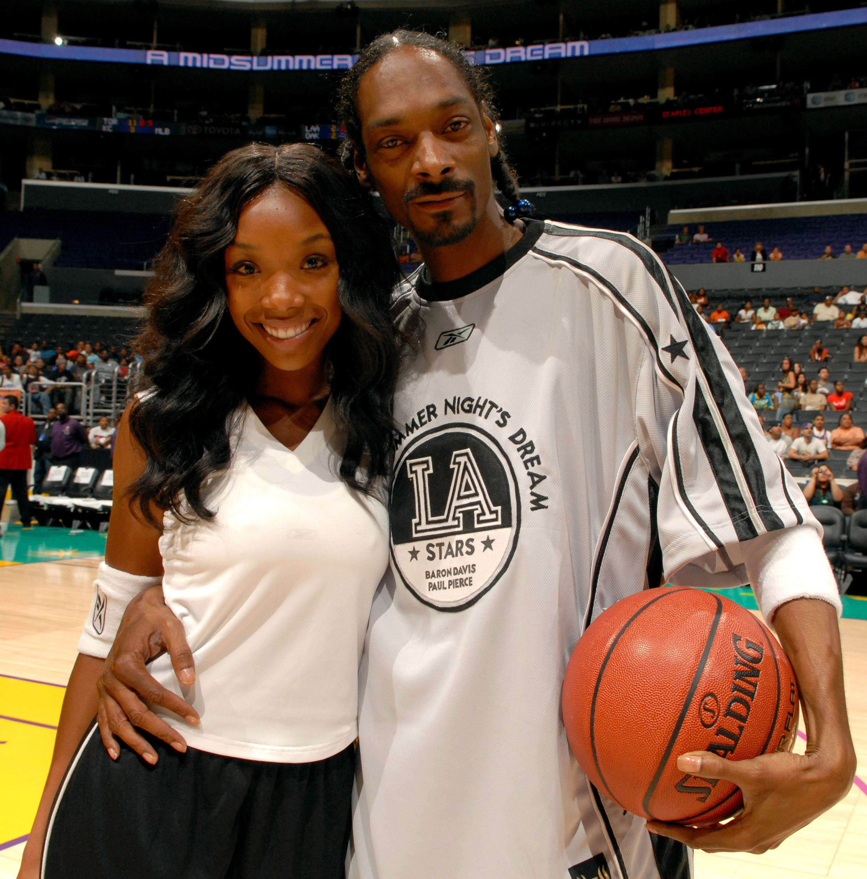 Snoop Dogg and Brandy at a basketball game