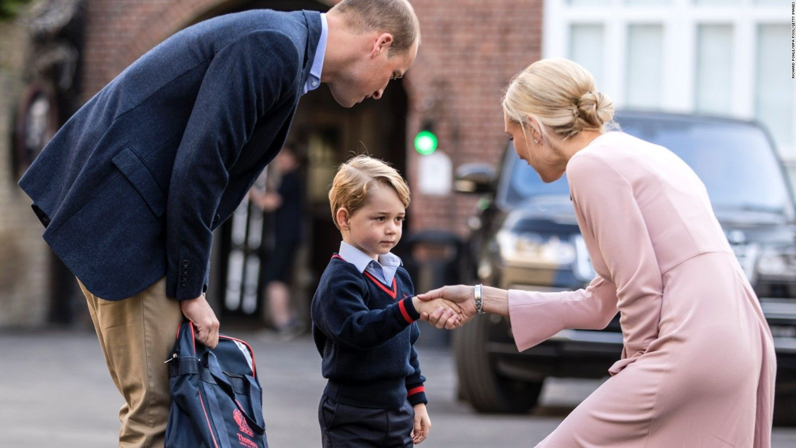 Prince George meeting his teacher on the first day of school