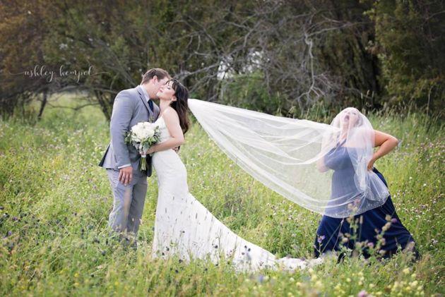 A bridesmaid in a bride's veil
