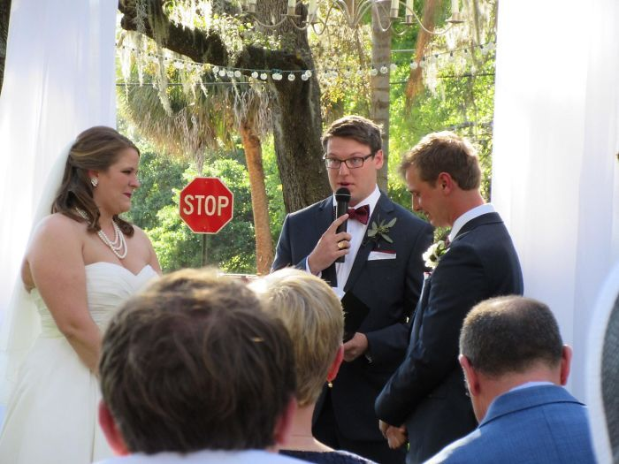 A wedding ceremony with a stop sign in the background