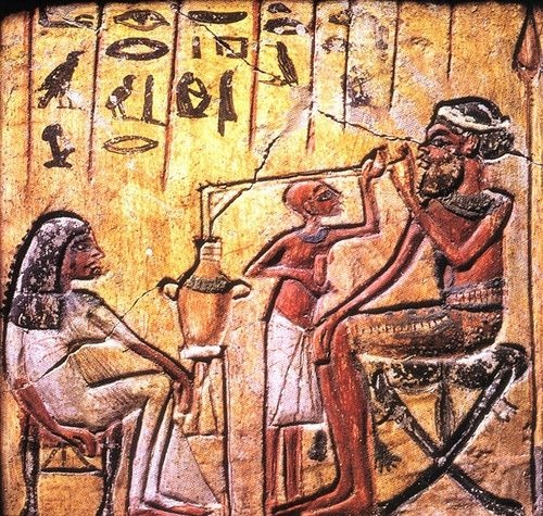 Ancient Egyptian art showing a man drinking beer