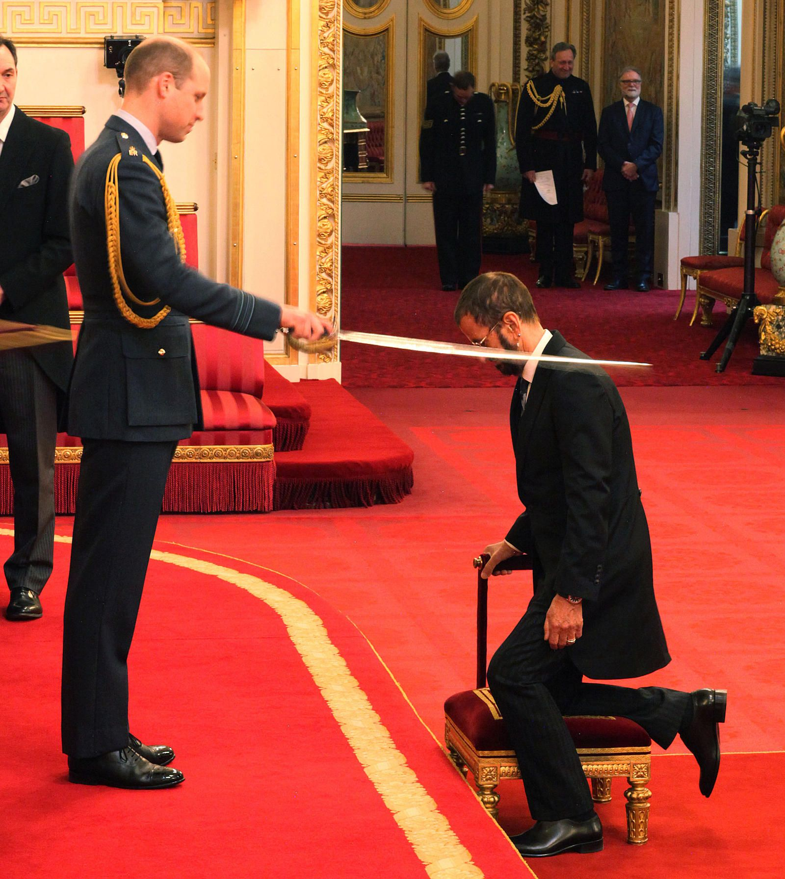 Ringo Starr being Knighted by Prince William