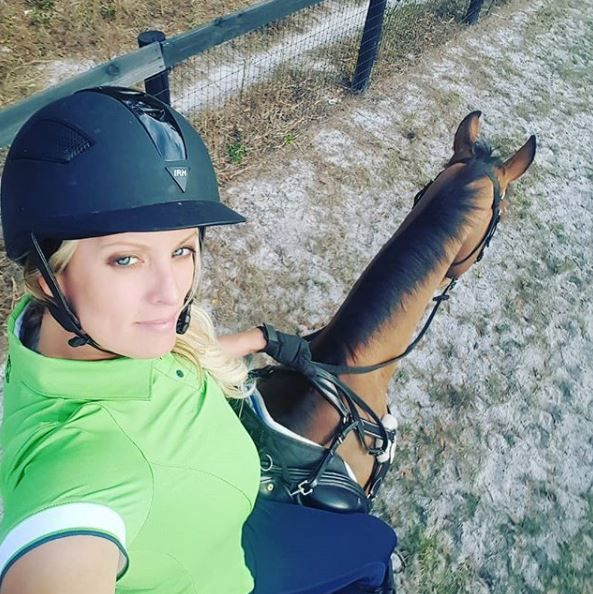 Stormy Daniels riding a horse