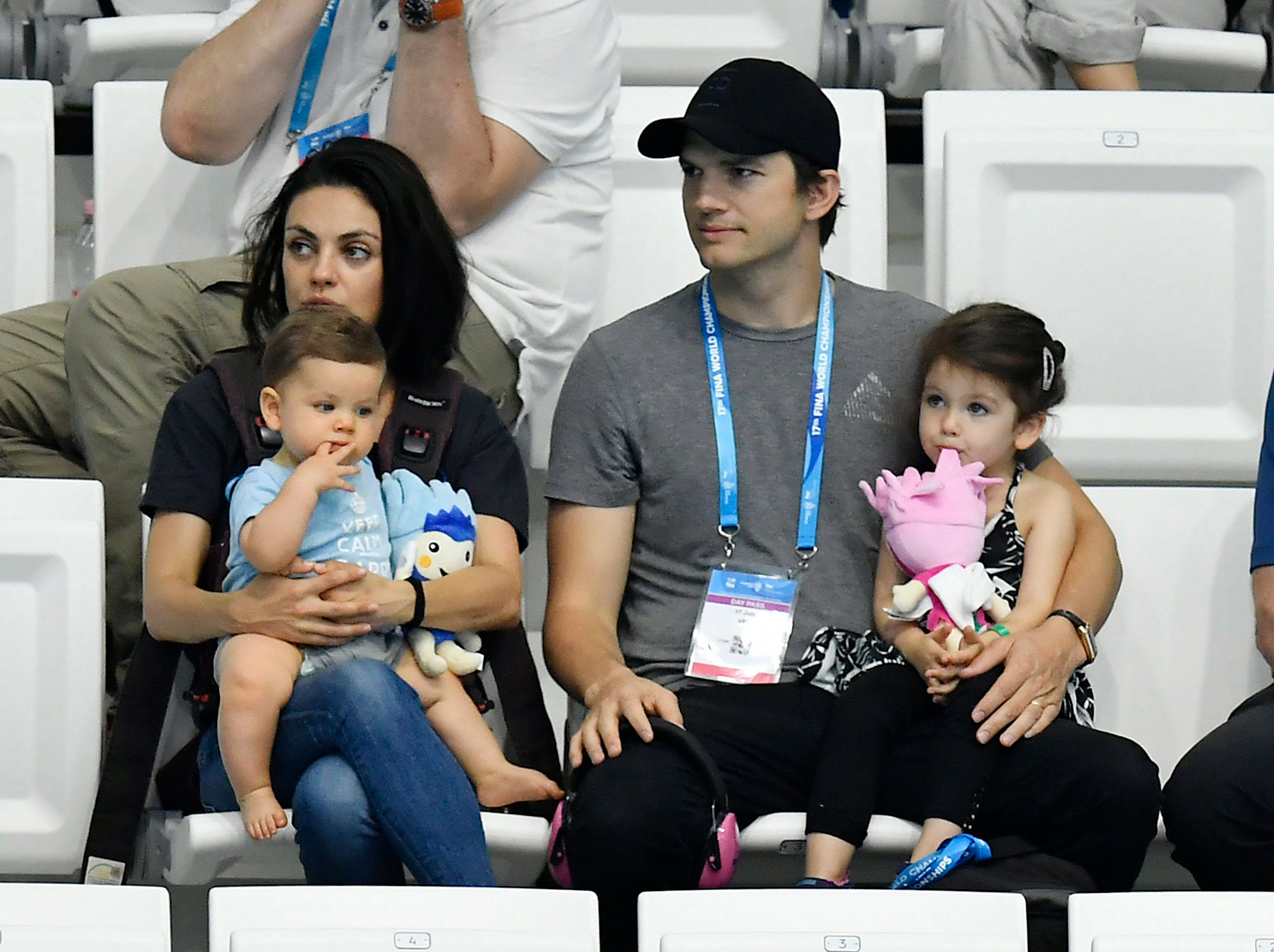 Ashton and Mila with their children