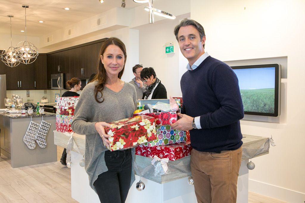 Jessica and Ben Mulroney with the packages