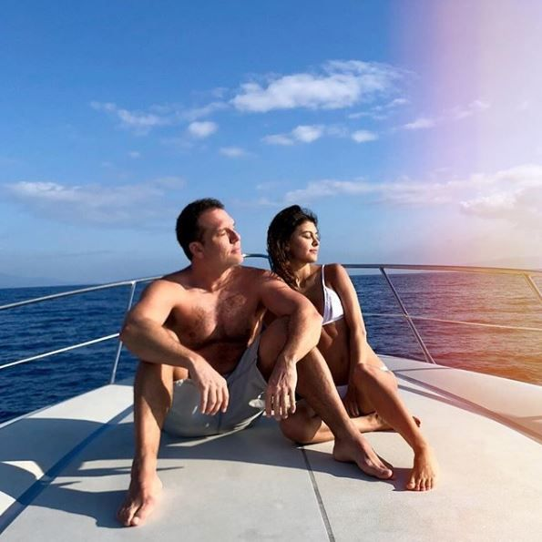 Dane Cook and Kelsi Taylor on a boat