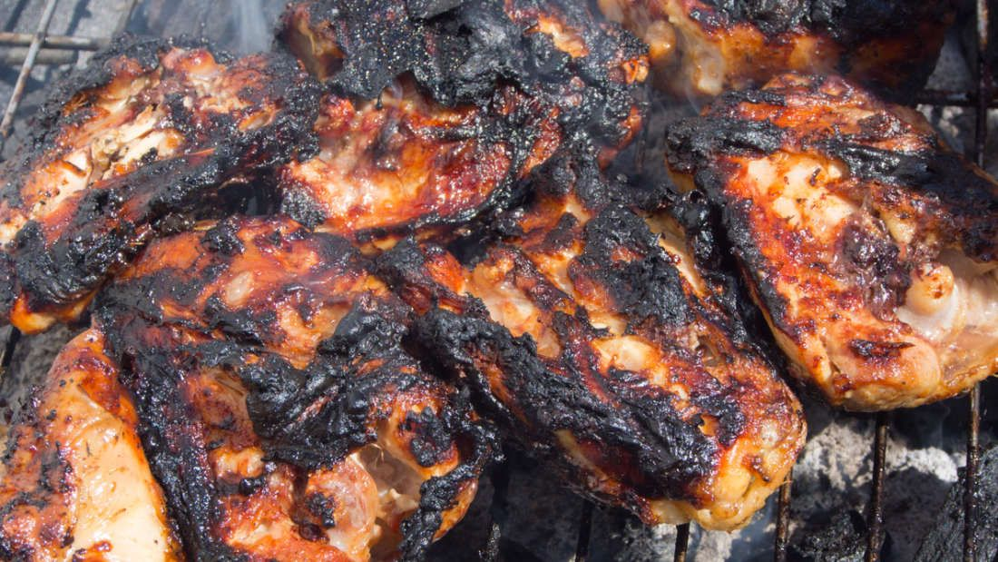 Charred chicken on the grill