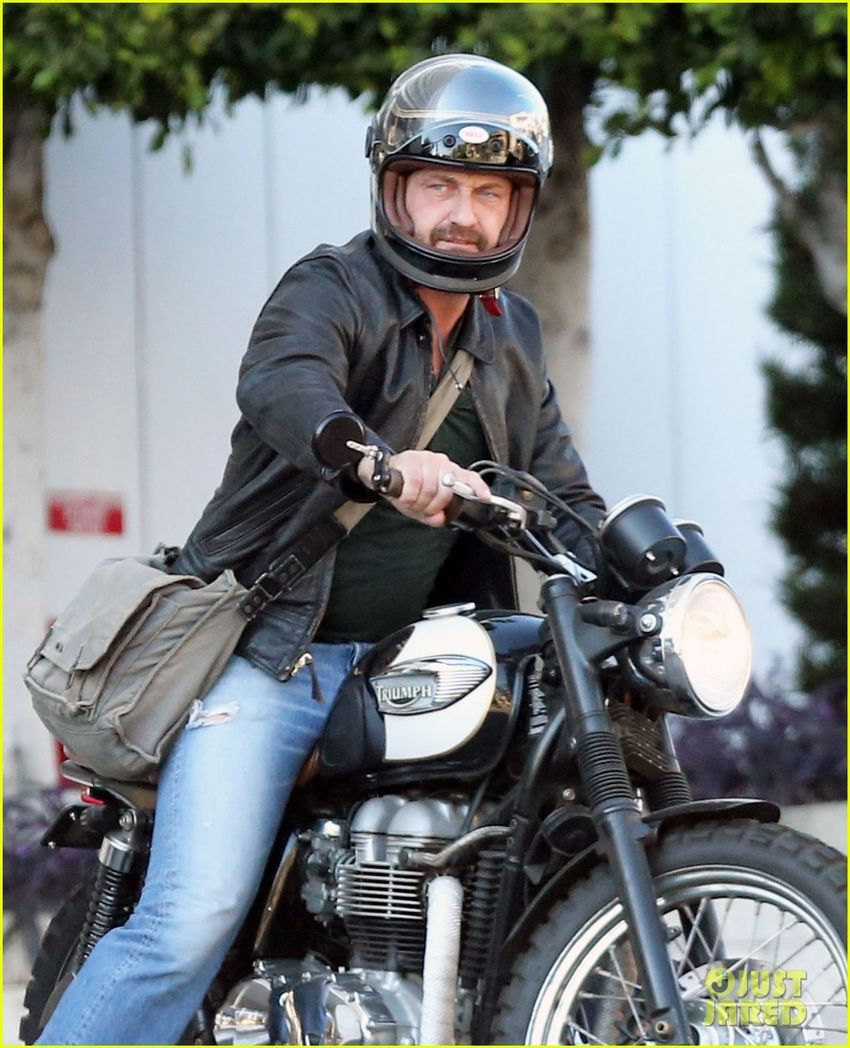Gerard Butler riding his motorcycle