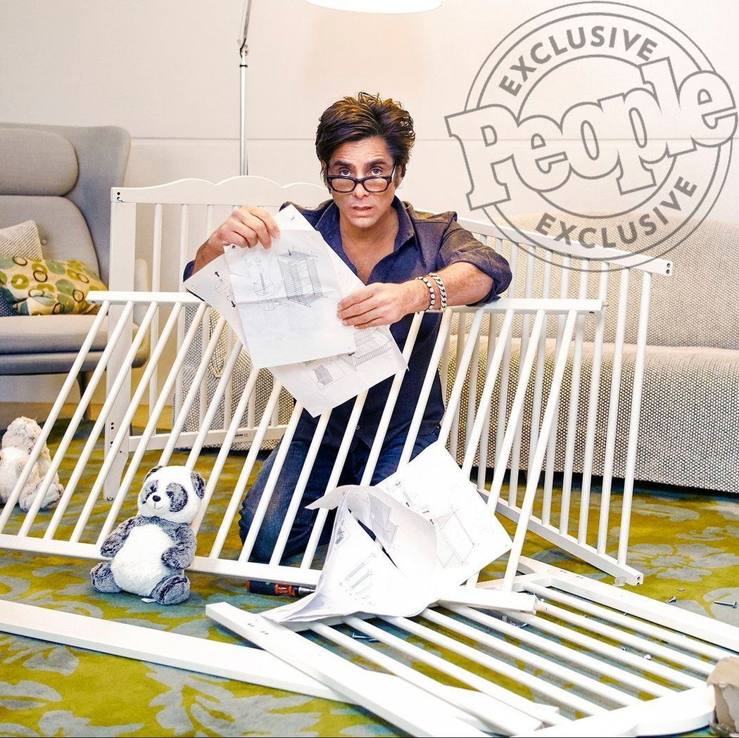 John Stamos trying to put together a crib