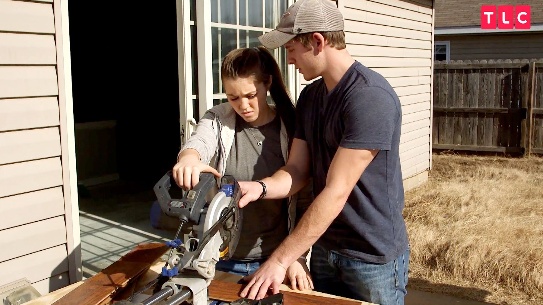 Joy-Anna and Austin sawing