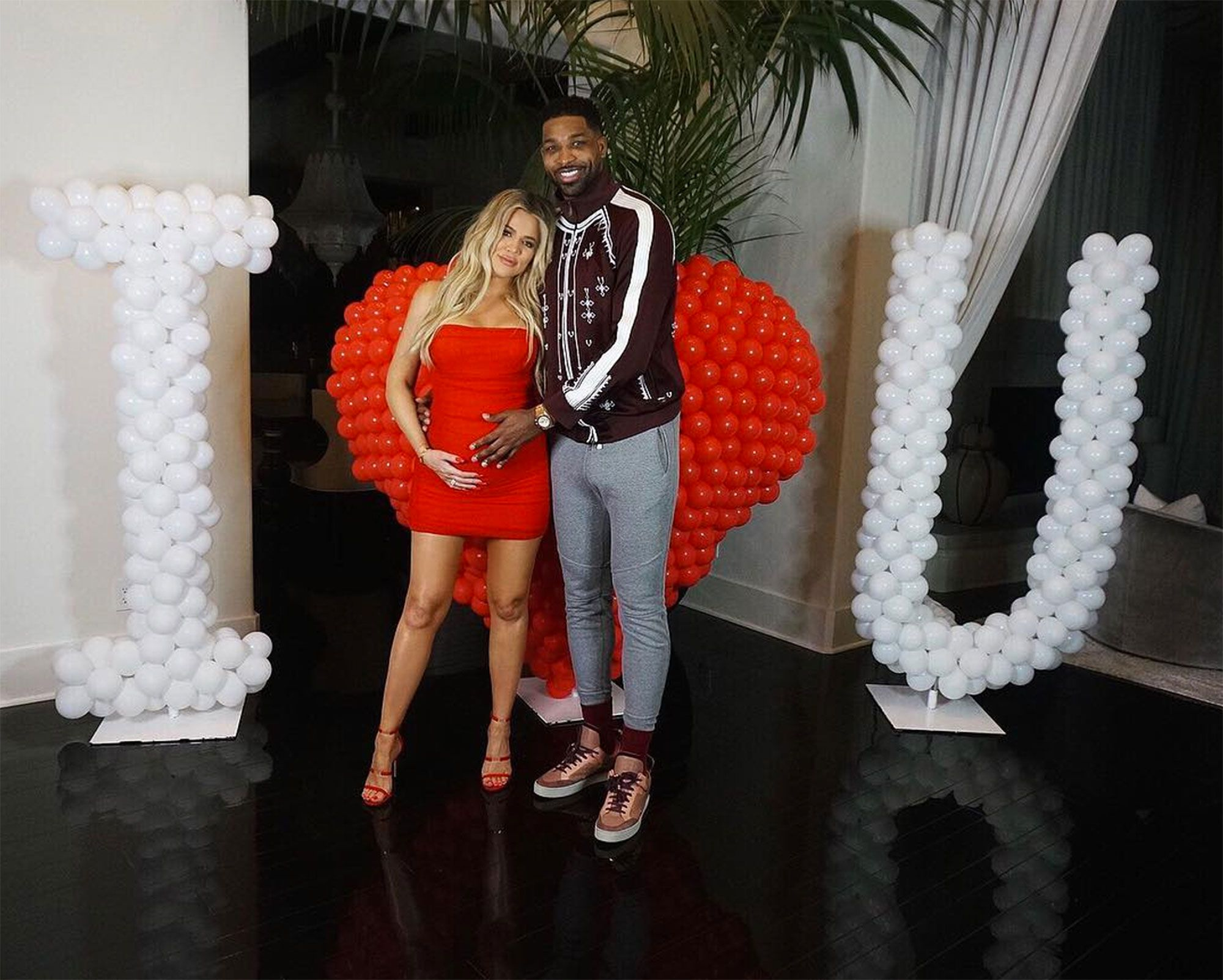 Khloe and Tristan posing for the cameras