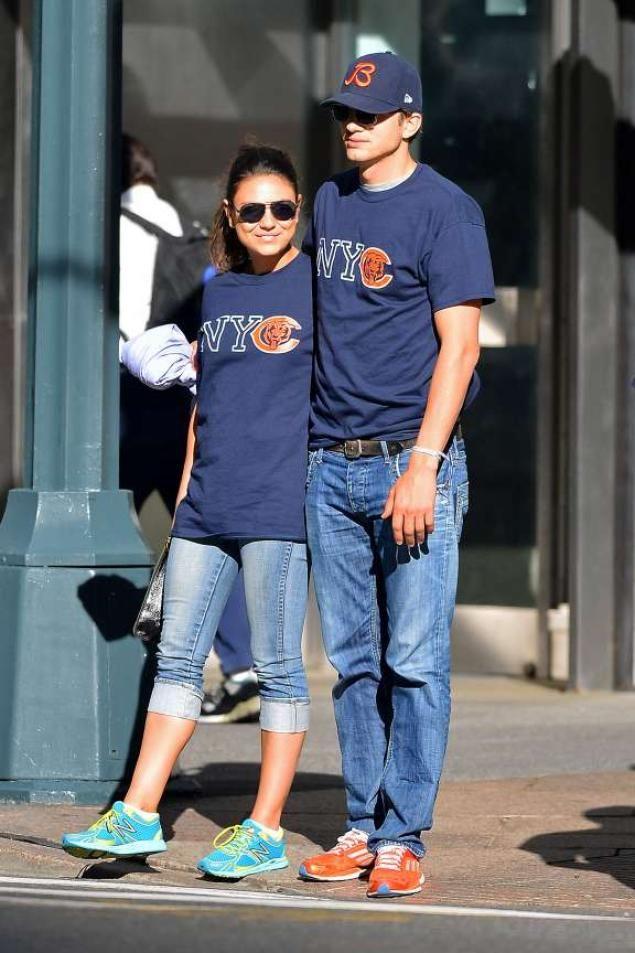 Ashton and Mila wearing matching shirts