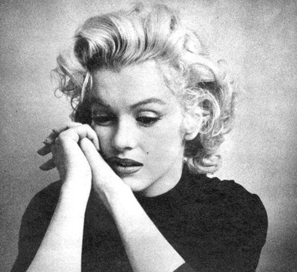 Marilyn Monroe posing looking sad