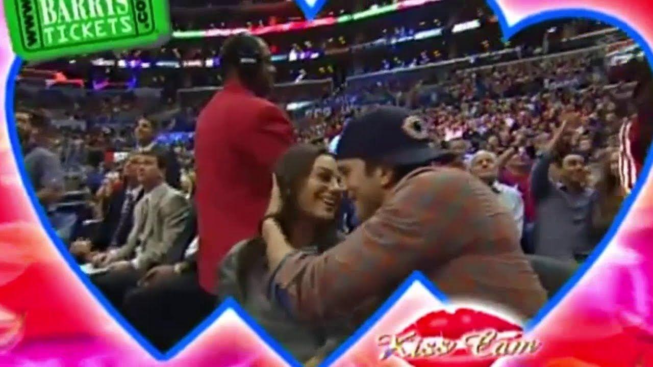 Ashton and Mila on the kiss cam