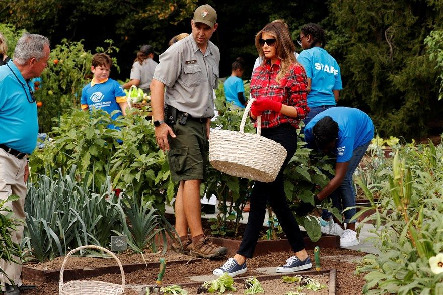 Melania Trump working in a gardan