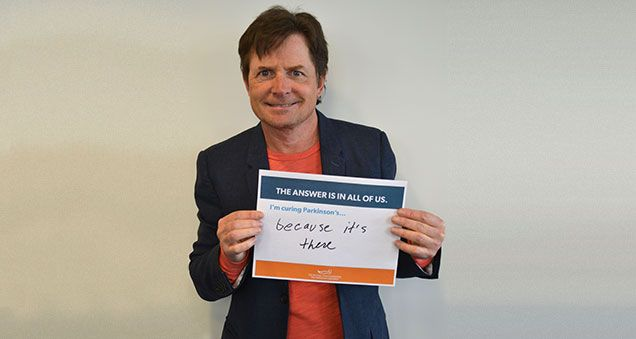 Michael J. Fox with placard