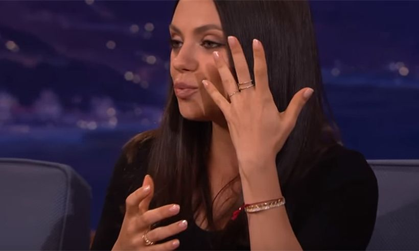 Mila shows off her wedding ring