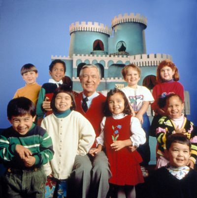 Mr. Rogers poses with a group of children