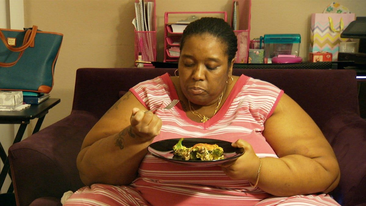 June McCamey eating dinner