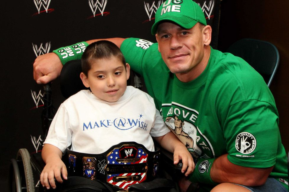 John Cena with a fan at a Make A Wish Foundation event