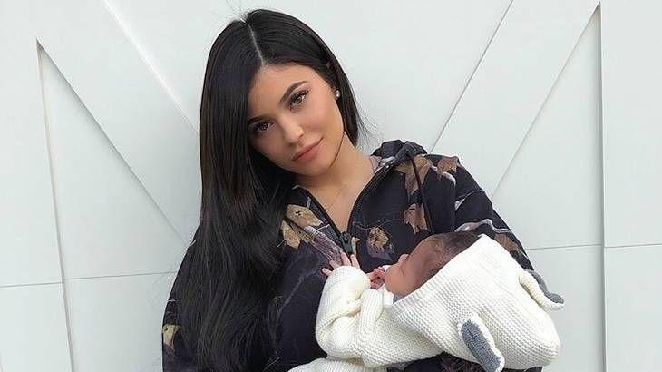 Kylie Jenner holding Stormi