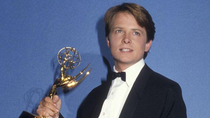 Michael J. Fox holding an Emmy Award