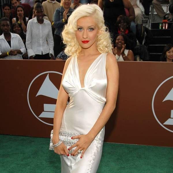 Christina Aguilera posing for photos at the Grammys