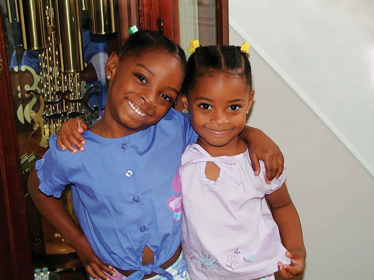 Simone Biles (left) and her sister Adria