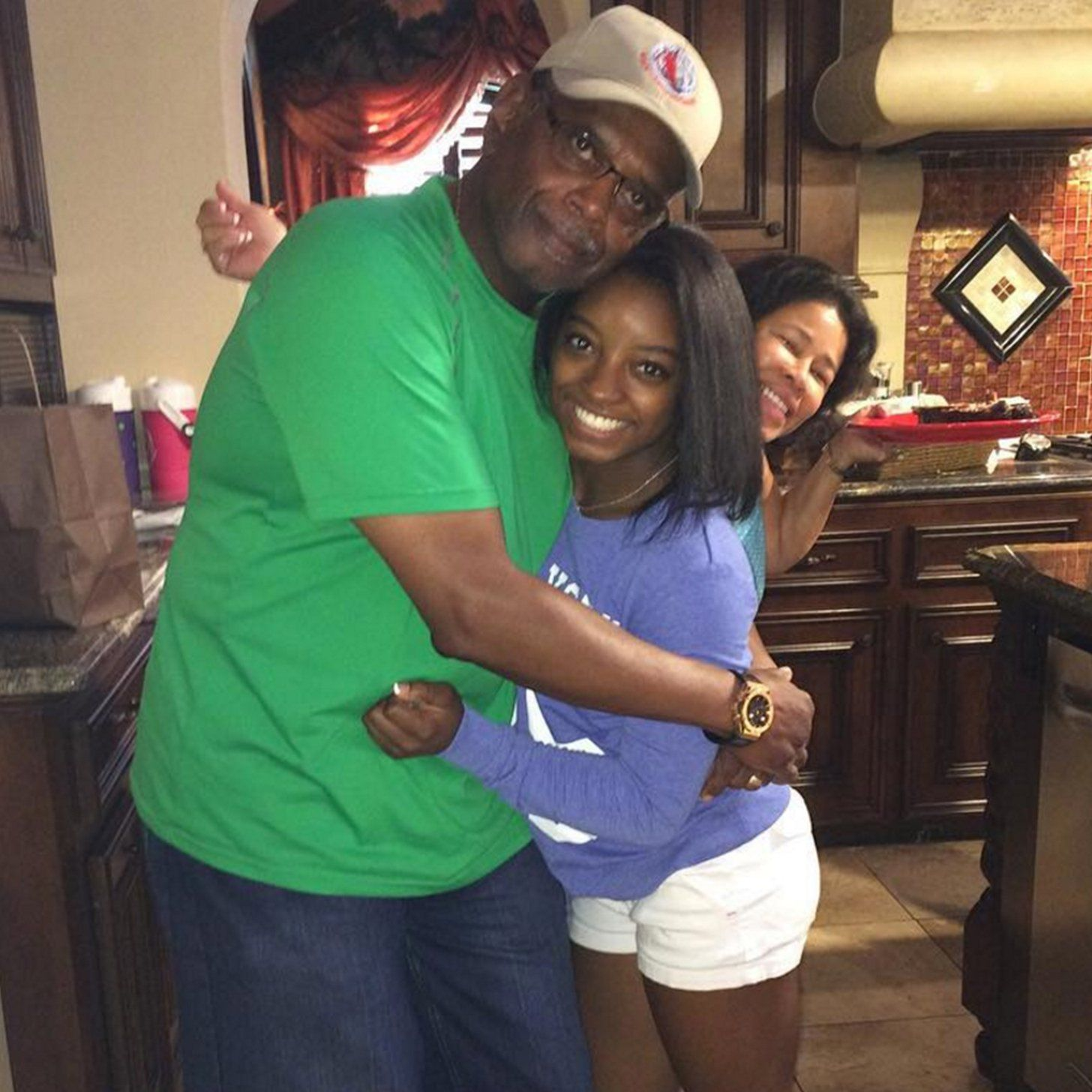 Simone Biles and parents