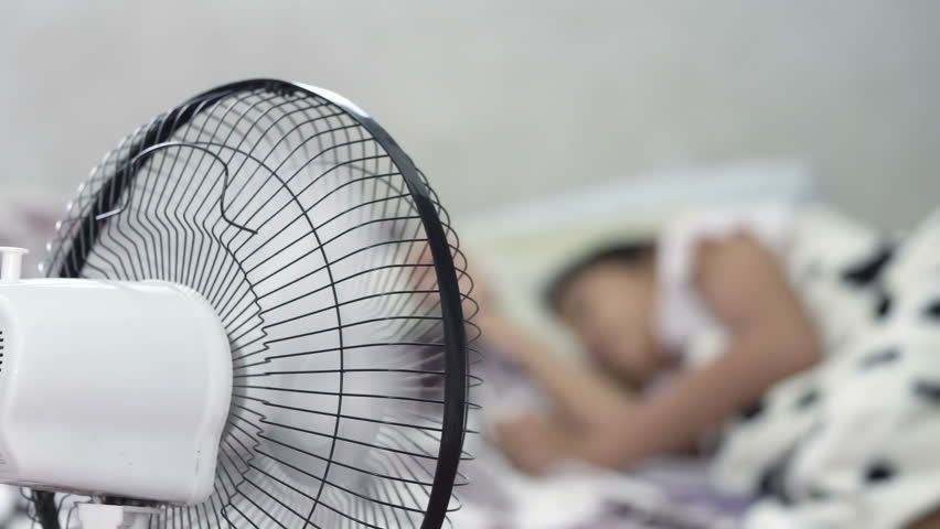 Somone sleeping with a fan on