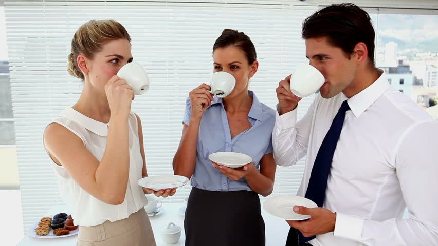 Office co-workers drinking coffee