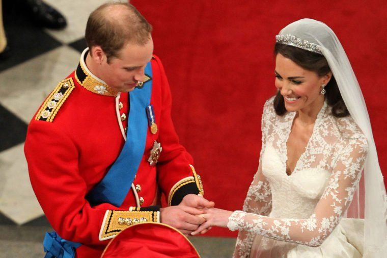 Prince William Putting on Kate's wedding band on her finger