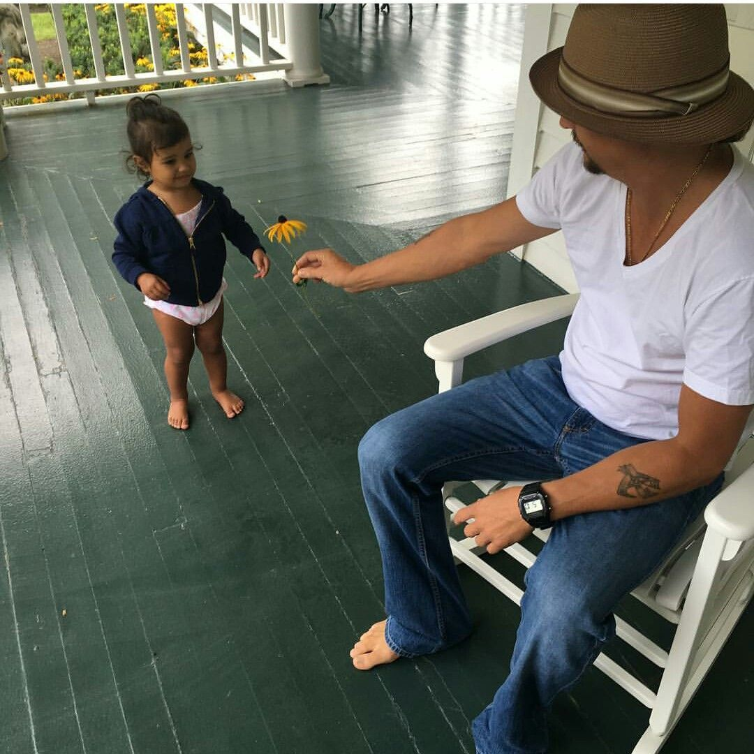 Kid Rock and his granddaughter on a porch