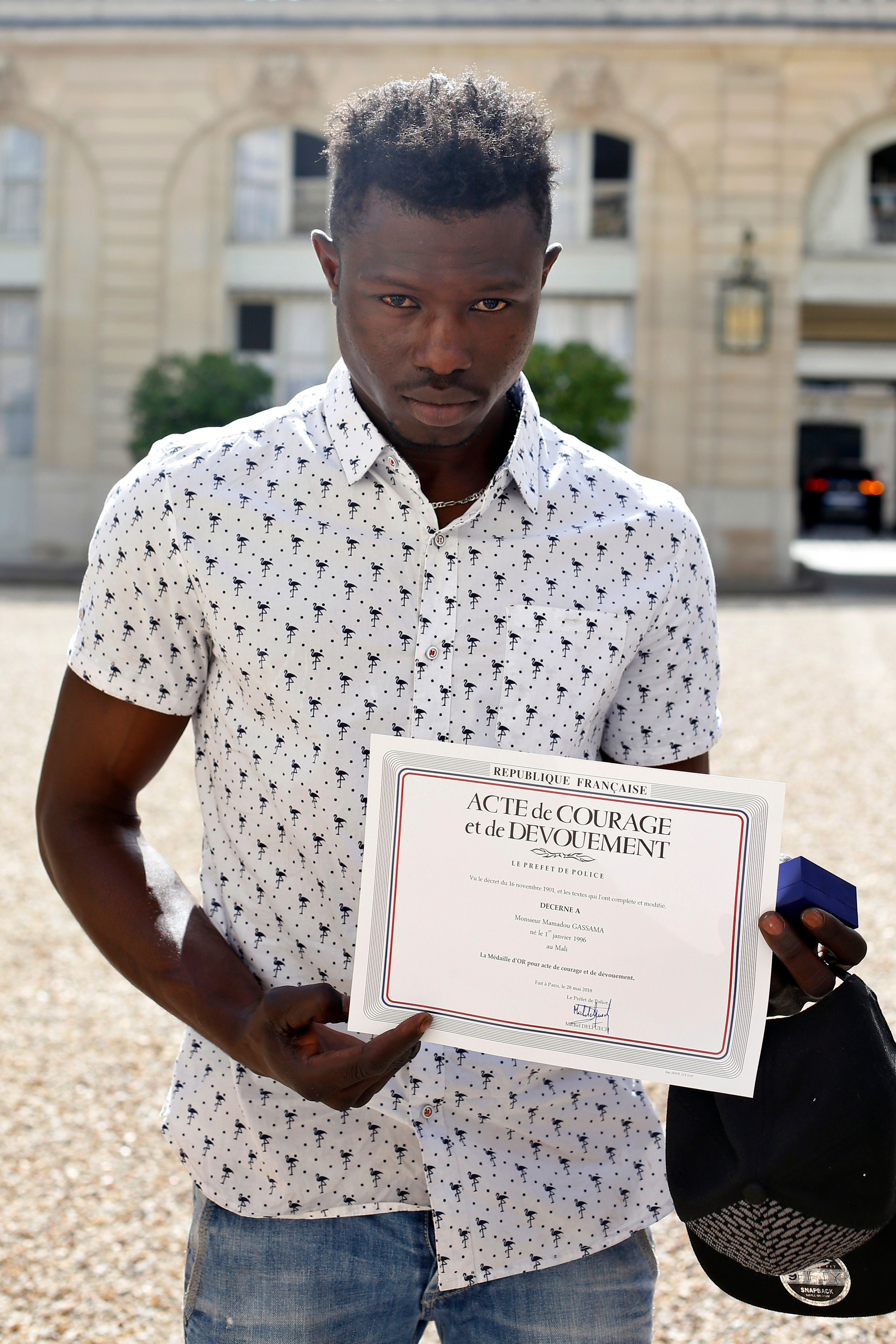 Mamoudou Gassama with his certificate