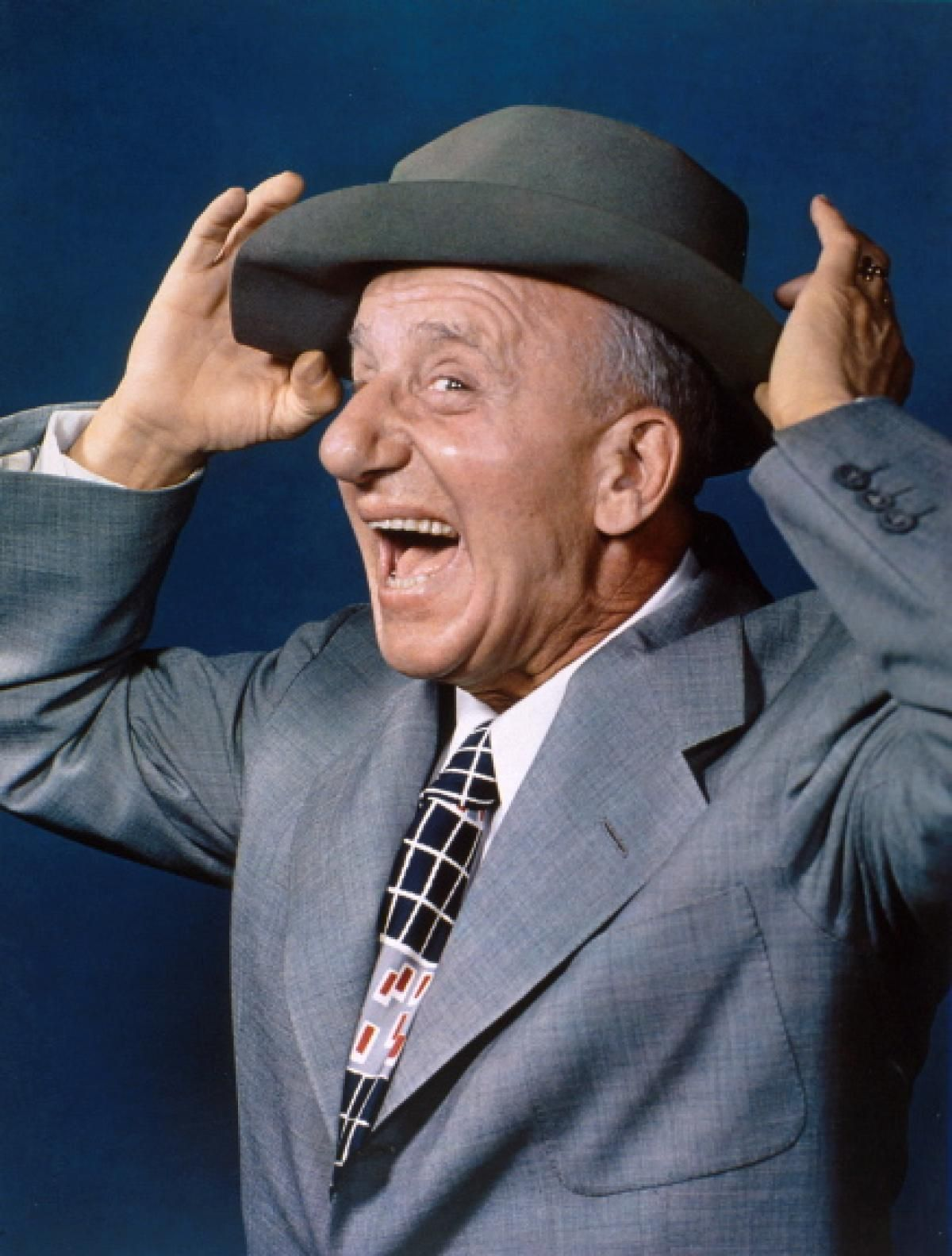 Jimmy Durante posing for a picture