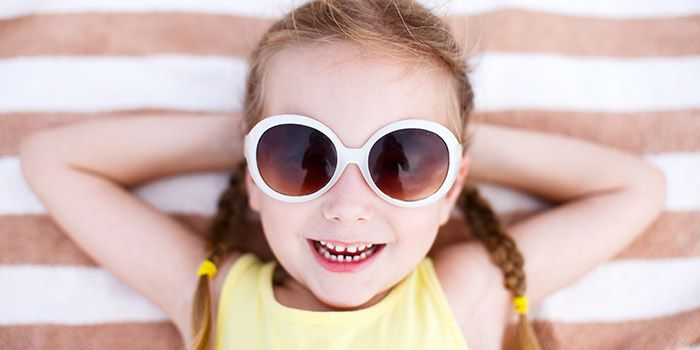 A child wearing sunglasses