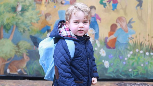 Prince George wearing a backpack